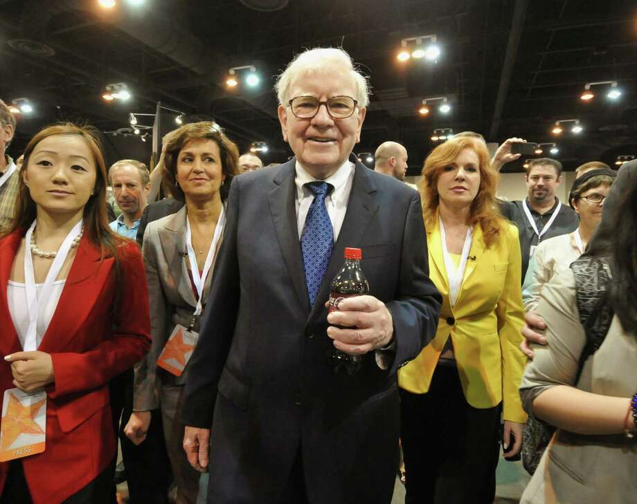 Warren Buffett, chairman and CEO of Berkshire Hathaway, tours the exhibit floor where Berkshire products are showcased, prior to the annual shareholders meeting in Omaha, Neb., Saturday, May 5, 2012. Berkshire Hathaway is holding it's annual shareholders meeting this weekend. (AP Photo/Dave Weaver) Photo: Dave Weaver