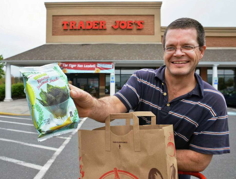 "Preston Liversidge of Amherst, Mass. holds up a bag of roasted seaweed snacks, ""They're awesome, my kids love 'em,"" outside Trader Joe's in Hadley, Mass. Friday May 4, 2012.  (John Carl D'Annibale / Times Union) Photo: John Carl D'Annibale / 00017567A"