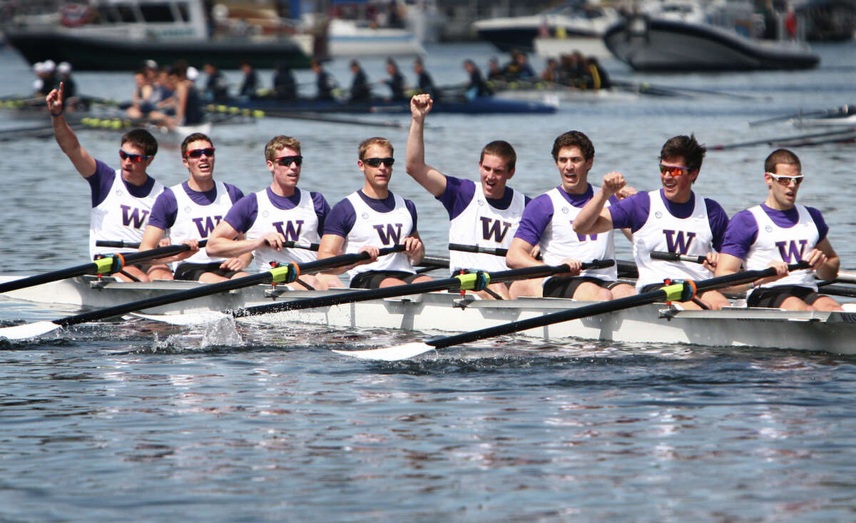 The University of Washington's men's varsity eight crosses the finish line to win the Windermere Cup during the annual regatta in the Montlake Cut on Saturday, May 5, 2012. The regatta and boat parade are the annual kickoff to the boating season in Seattle.