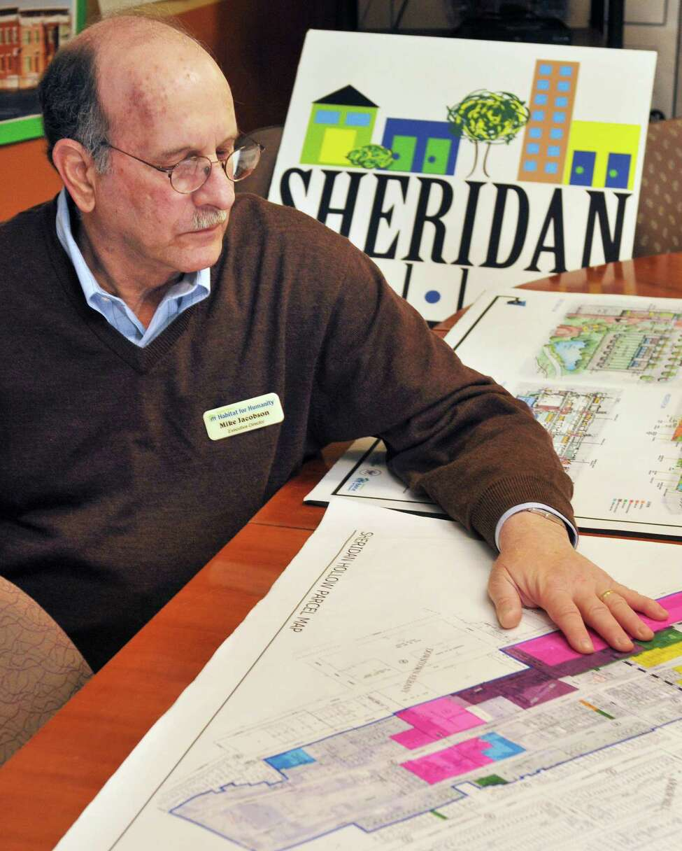 Capital District Habitat for Humanity executive director Michael Jacobson discusses the organization's ambitious plans to remake the entire Sheridan Hollow neighborhood during an interview in Albany Wednesday April 25, 2012, a project he says may be the most ambitious ever undertaken by any Habitat for Humanity chapter anywhere. (John Carl D'Annibale / Times Union)