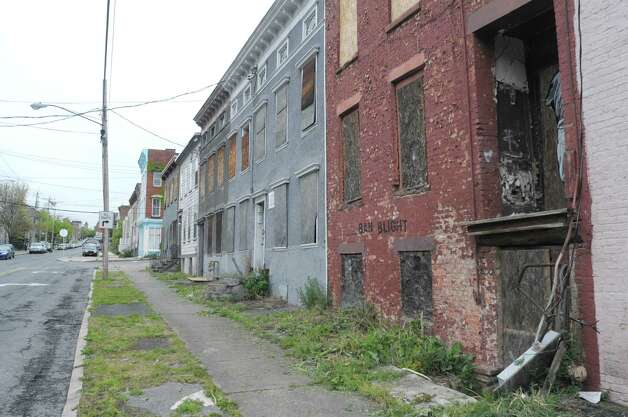 "A view of some abandoned buildings on Sheridan Ave. just east of Swan St. on Wednesday, May 2, 2012 in Albany, NY.  Habitat for Humanity has plans to remake the entire neighborhood, rehabbing some buildings and building new structures on some of the empty lots. Graffiti on the red-brick building says ""Ban Blight.""  (Paul Buckowski / Times Union) Photo: Paul Buckowski"