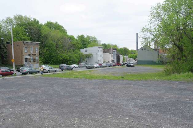 A view of an empty lot on Sheridan Ave. near the corner of Dove St. on Wednesday, May 2, 2012 in Albany, NY.  Habitat for Humanity has plans to remake the entire neighborhood, rehabbing some buildings and building new structures on some of the empty lots.  This lot and the lot across the street would be a mixed use with some residential and some housing.  (Paul Buckowski / Times Union) Photo: Paul Buckowski