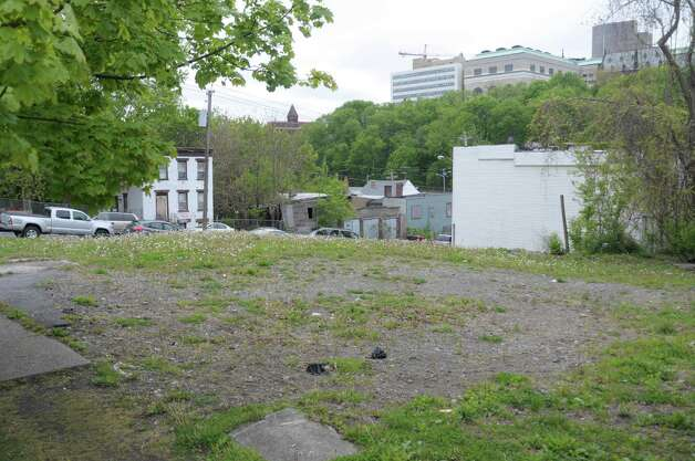 A view of an empty lot on the corner of Orange St. and Swan St. on Wednesday, May 2, 2012 in Albany, NY.  Habitat for Humanity has plans to remake the entire neighborhood, rehabbing some buildings and building new structures on some of the empty lots.  (Paul Buckowski / Times Union) Photo: Paul  Buckowski