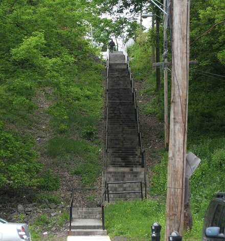 A view of the stairs that lead from Swan St. up to Elk St. seen here on Wednesday, May 2, 2012 in Albany, NY.  Habitat for Humanity has plans to remake the entire neighborhood, rehabbing some buildings and building new structures on some of the empty lots.  (Paul Buckowski / Times Union) Photo: Paul Buckowski
