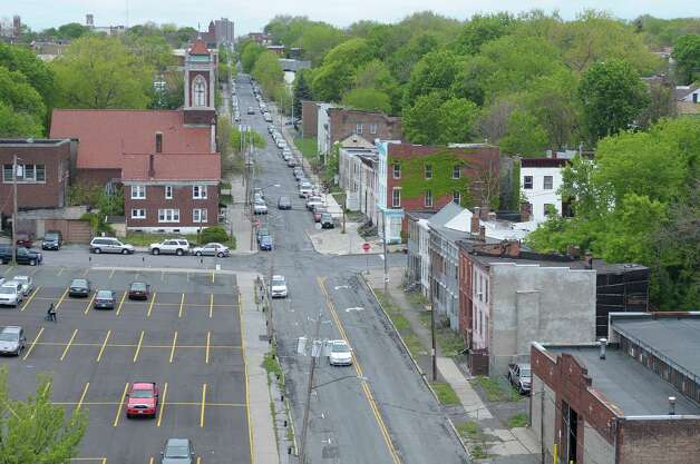 A view looking west on Sheridan Ave.  on Wednesday, May 2, 2012 in Albany, NY.  Habitat for Humanity has plans to remake the entire neighborhood, rehabbing some buildings and building new structures on some of the empty lots.  (Paul Buckowski / Times Union) Photo: Paul Buckowski