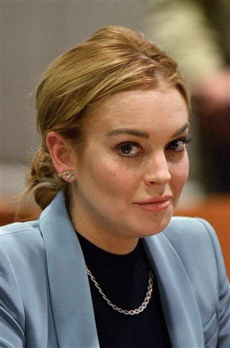 Lindsay Lohan is seen during a progress report on her probation for theft charges at Los Angeles Superior Court Thursday, March 29, 2012. A judge ended Lindsay Lohan's supervised probation on Thursday, giving the actress her freedom after nearly two years of constant court hearings and threats of jail. Lohan thanked Superior Court Judge Stephanie Sautner for her patience and let out a sigh of relief as she exited the courtroom after the brief hearing. (AP Photo/Joe Klamar, Pool) Photo: Joe Klamar / Agence-France-Presse