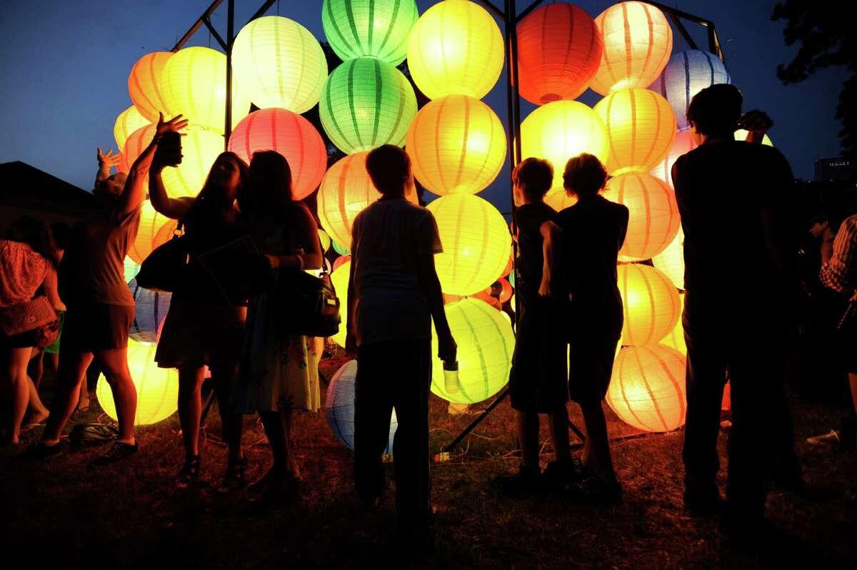 People explore a lantern display during Luminaria 2012 in Hemisfair Park on Saturday, May 5, 2012.