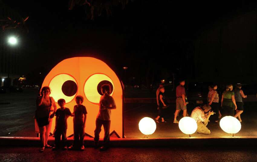 A lighted Pac Man display greets visitors during Luminaria 2012 in Hemisfair Park on Saturday, May 5, 2012.