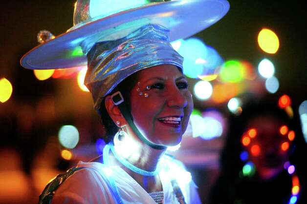 Sylvia Casillas-Ramirez of the group Urban 15 smiles as she wears a lighted costume during Luminaria 2012 in Hemisfair Park on Saturday, May 5, 2012. Billy Calzada / San Antonio Express-News Photo: BILLY CALZADA, San Antonio Express-News / SAN ANTONIO EXPRESS-NEWS