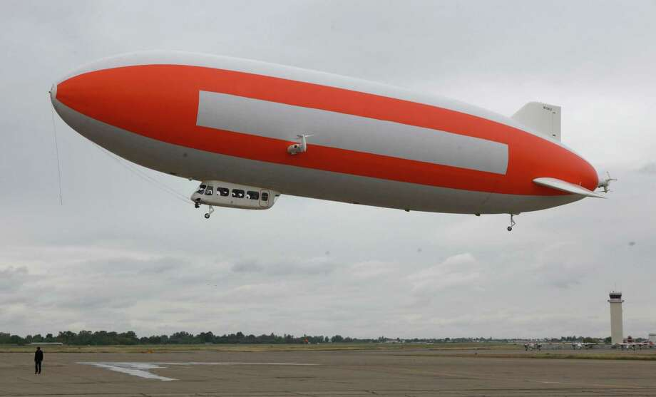 Carrying scientists and researchers, the zeppelin Eureka lifts off from McClellan Air Park in Sacramento, Calif., to search for pieces of a meteor that exploded April 22. Photo: Rich Pedroncelli / AP