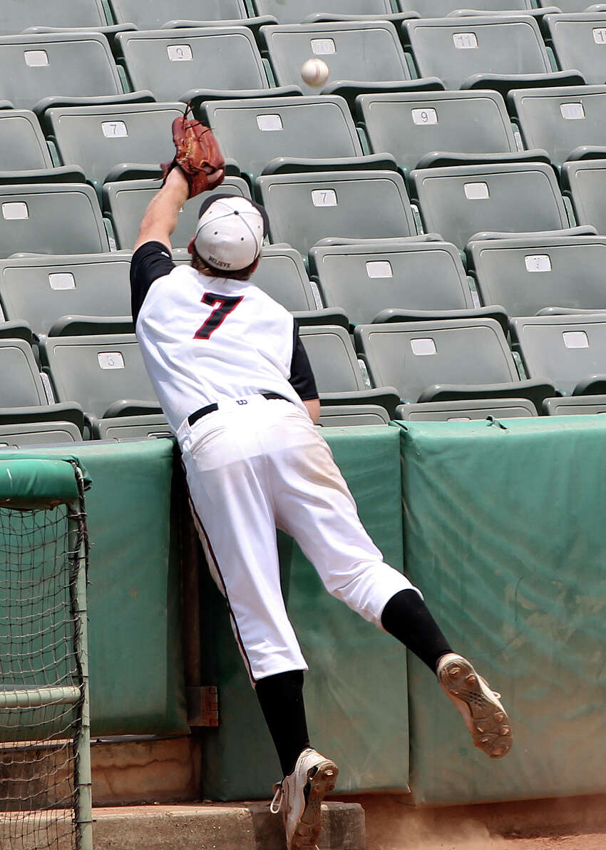 Charger infielder Justin Kelly gets in the seats trying to catch a pop foul as Churchill beats New Braunfels 6-5 in baseball playoff action at Wolff Stadium on May 5, 2012. Tom Reel/ San Antonio Express-News
