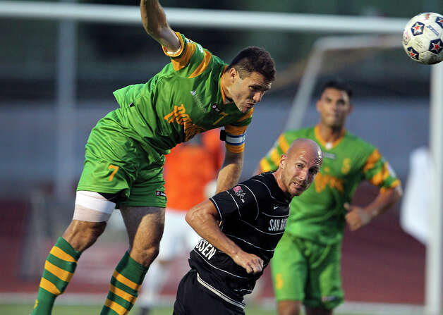 The Rowdies' Frankie Sanfilippo bumps the ball away from Hans Denissen as the Scorpions host Tampa Bay in NASL action at Heroes  Stadium  on May 5, 2012.  Tom Reel/ San Antonio Express-News Photo: TOM REEL, Express-News / San Antonio Express-News