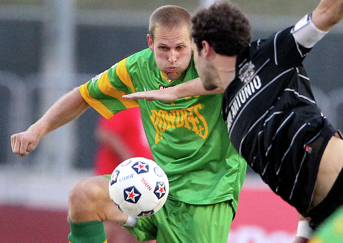 The Rowdies' Keith Savage controls as Kevin Harmse can't reach him as the Scorpions host Tampa Bay in NASL action at Heroes Stadium on May 5, 2012. Tom Reel/ San Antonio Express-News