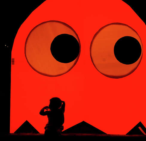 "A child explores a ""Pac Man ghost"" during Luminaria 2012 in Hemisfair Park on Saturday, May 5, 2012. Photo: BILLY CALZADA, San Antonio Express-News / SAN ANTONIO EXPRESS-NEWS"