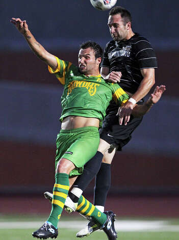 San antonio's Ryan Cochrane controls a header against Matt Clare as the Scorpions host Tampa Bay in NASL action at Heroes  Stadium  on May 5, 2012.  Tom Reel/ San Antonio Express-News Photo: TOM REEL, Express-News / San Antonio Express-News