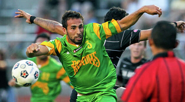 The Rowdies' Andres Arango controls against Pablo Campos as the Scorpions host Tampa Bay in NASL action at Heroes  Stadium  on May 5, 2012.  Tom Reel/ San Antonio Express-News Photo: TOM REEL, Express-News / San Antonio Express-News