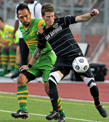 San Antonio's Wes Knight moves the ball against Takuya Yamada as the Scorpions host Tampa Bay in NASL action at Heroes  Stadium  on May 5, 2012.  Tom Reel/ San Antonio Express-News Photo: TOM REEL, Express-News / San Antonio Express-News