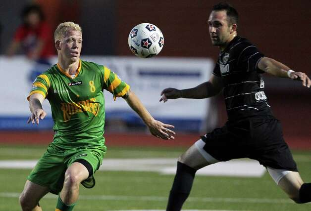 The Rowdies' Luke Mulholland comes back to the ball against Ryan Cochrane as the Scorpions host Tampa Bay in NASL action at Heroes  Stadium  on May 5, 2012.  Tom Reel/ San Antonio Express-News Photo: TOM REEL, Express-News / San Antonio Express-News