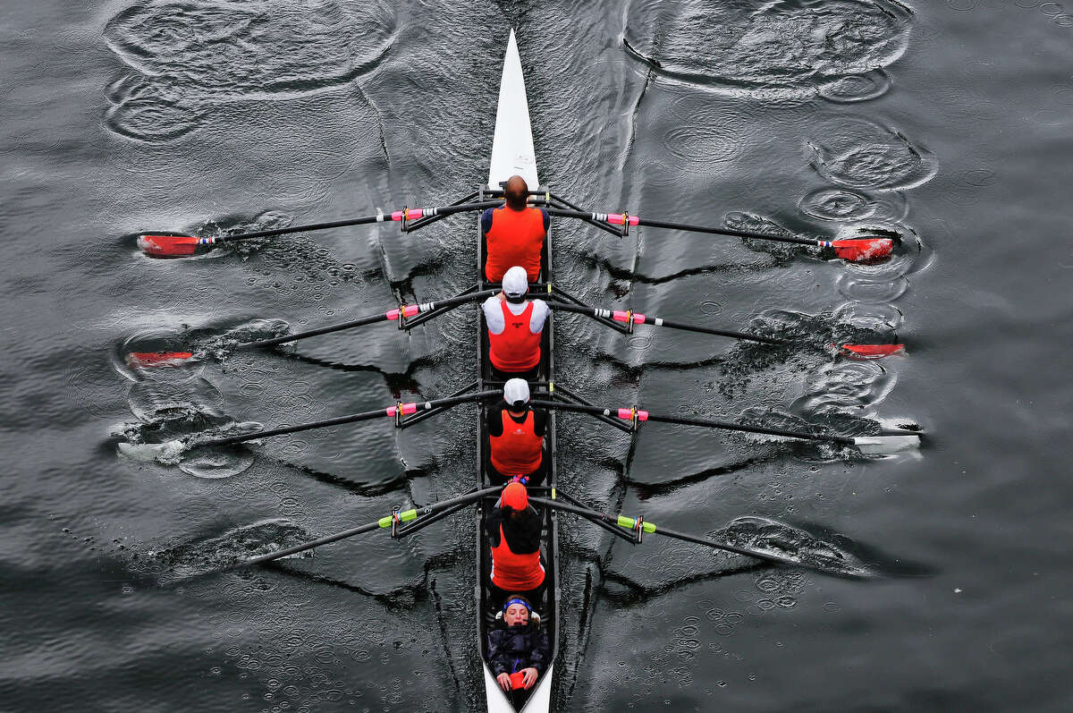 Rowers begin to pass under the Montlake Bridge during the Windermere Cup.