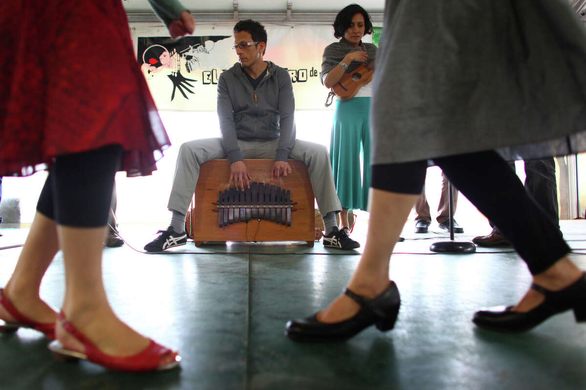 Members of the Seattle Fandango Project, including Cisco Orozco on the marimbol, perform.