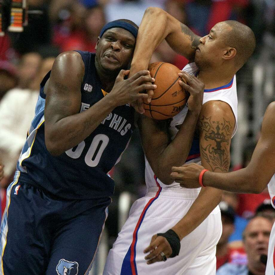 The Clippers' Caron Butler, right, tries to strong-arm the Grizzlies' Zach Randolph in the first half Saturday. Photo: Gina Ferazzi / Los Angeles Times