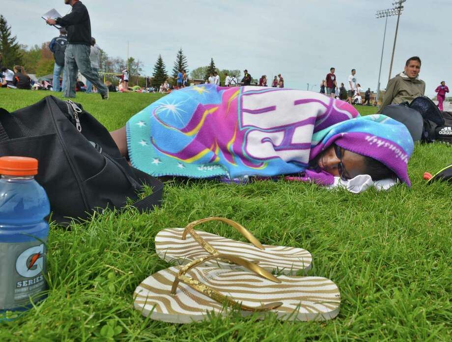 Ravena sprinter Karra Douglas rests after competing in the girls' 100m dash at the Colonie Relays at Colonie High Saturday May 5, 2012.   (John Carl D'Annibale / Times Union) Photo: John Carl D'Annibale / 00017535A