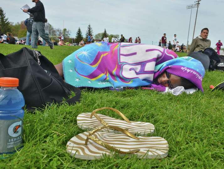 Ravena sprinter Karra Douglas rests after competing in the girls' 100m dash at the Colonie Relays at