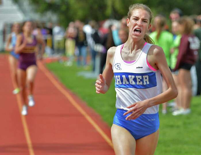 Shaker eighth grader Maryanna Lansing wins the girls' 1500 meters easily at the Colonie Relays at Co