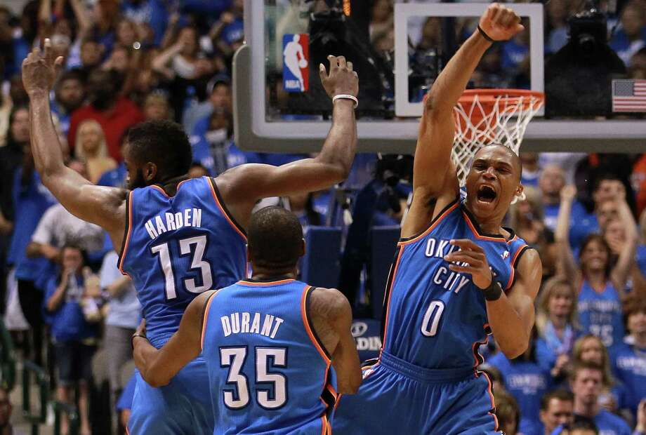 The Thunder's James Harden, from left, Kevin Durant and Russell Westbrook put an exclamation point on their victory over the Mavericks as time expires. Photo: Ronald Martinez / 2012 Getty Images