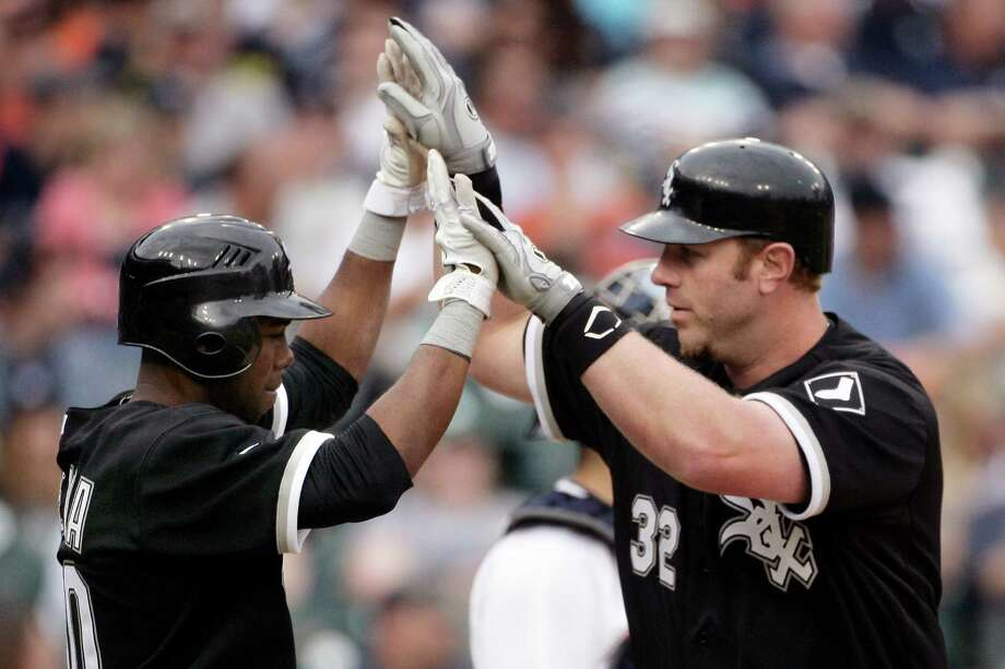 Chicago's Adam Dunn (32) celebrates with Alejandro De Aza after hitting a go-ahead, two-run home run in the ninth inning off Detroit's Jose Valverde. Photo: Duane Burleson / FR38952 AP
