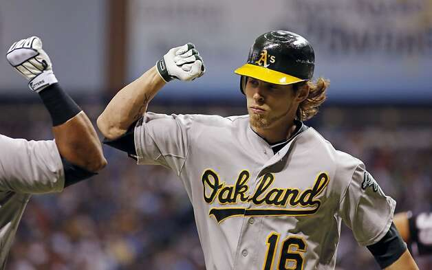 Oakland Athletics Josh Reddick celebrates after hitting a home run against Tampa Bay Rays Jeremy Hellickson during the first inning of a baseball game, Saturday, May 5, 2012, in St. Petersburg, Fla. Photo: Scott Iskowitz, Associated Press