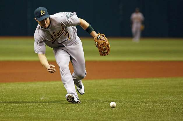 Oakland Athletics Adam Rosales runs to field a ball hit by Tampa Bay Rays Carlos Pena during a baseball game, Saturday, May 5, 2012, in St. Petersburg, Fla. Photo: Scott Iskowitz, Associated Press