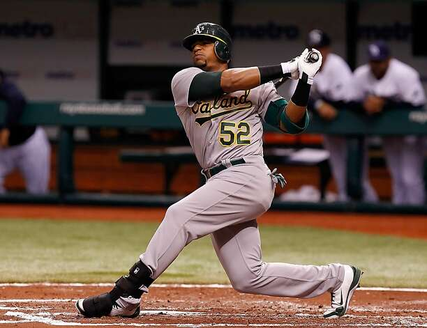 Outfielder Yoenis Cespedes #52 of the Oakland Athletics fouls off a pitch against the Tampa Bay Rays during the game at Tropicana Field on May 5, 2012 in St. Petersburg, Florida. Photo: J. Meric, Getty Images