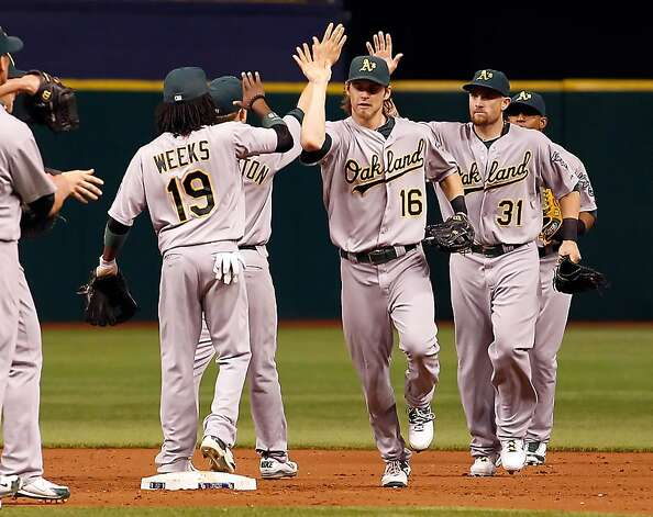 The Oakland Athletics celebrate their victory over the Tampa Bay Rays at Tropicana Field on May 5, 2012 in St. Petersburg, Florida. Photo: J. Meric, Getty Images