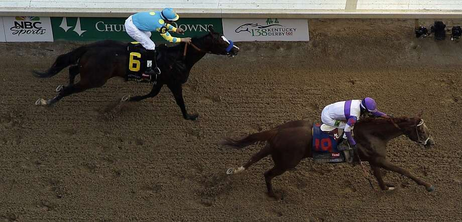 Jockey Mario Gutierrez rides I'll Have Another past Bodemeister ridden by Mike Smith (6) to victory in the 138th Kentucky Derby horse race at Churchill Downs Saturday, May 5, 2012, in Louisville, Ky. (AP Photo/Charlie Riedel) Photo: Charlie Riedel, Associated Press