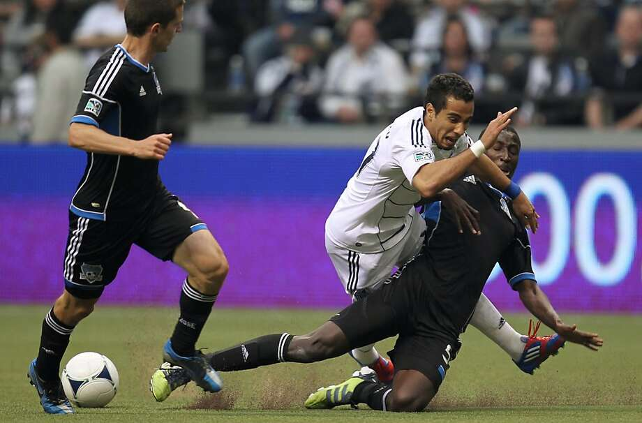 Vancouver Whitecaps' Camilo Sanvezzo, of Brazil, center, and San Jose Earthquakes Ike Opara, right fight for control of the ball during the second half of MLS soccer action in Vancouver, Saturday, May 5, 2012. (AP Photo/The Canadian Press, Jonathan Hayward) Photo: Jonathan Hayward, Associated Press
