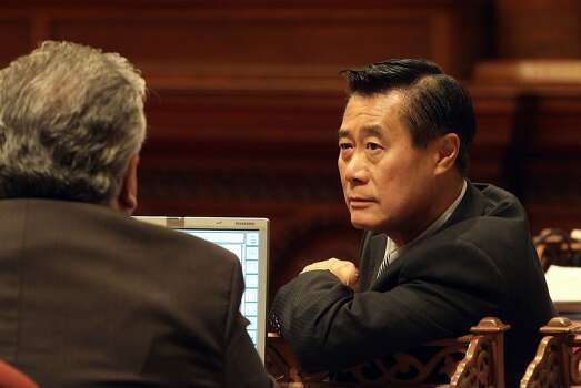 Senator Leland Yee- D of San Francisco,(right)  and Senator Ron Calderon, of Montebello, in a discussion on the floor of the Senate Chamber at the State Capitol, in Sacramento, Ca., on Thursday May 3, 2012.  Photo: Michael Macor, The Chronicle