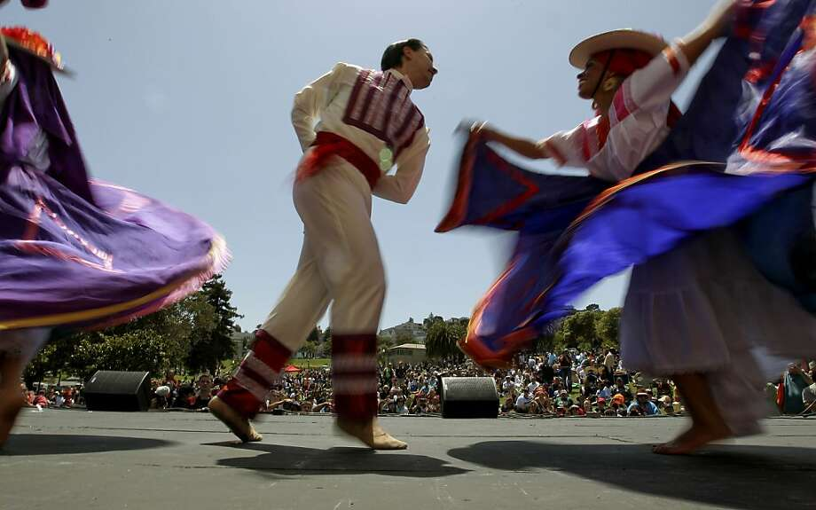 Dancers with  Ballet Folklorico de San Francisco take the stage, during the annual Cinco de Mayo celebration in Dolores Park on Saturday May 5, 2012,  in San Francisco, Ca. Photo: Michael Macor, The Chronicle