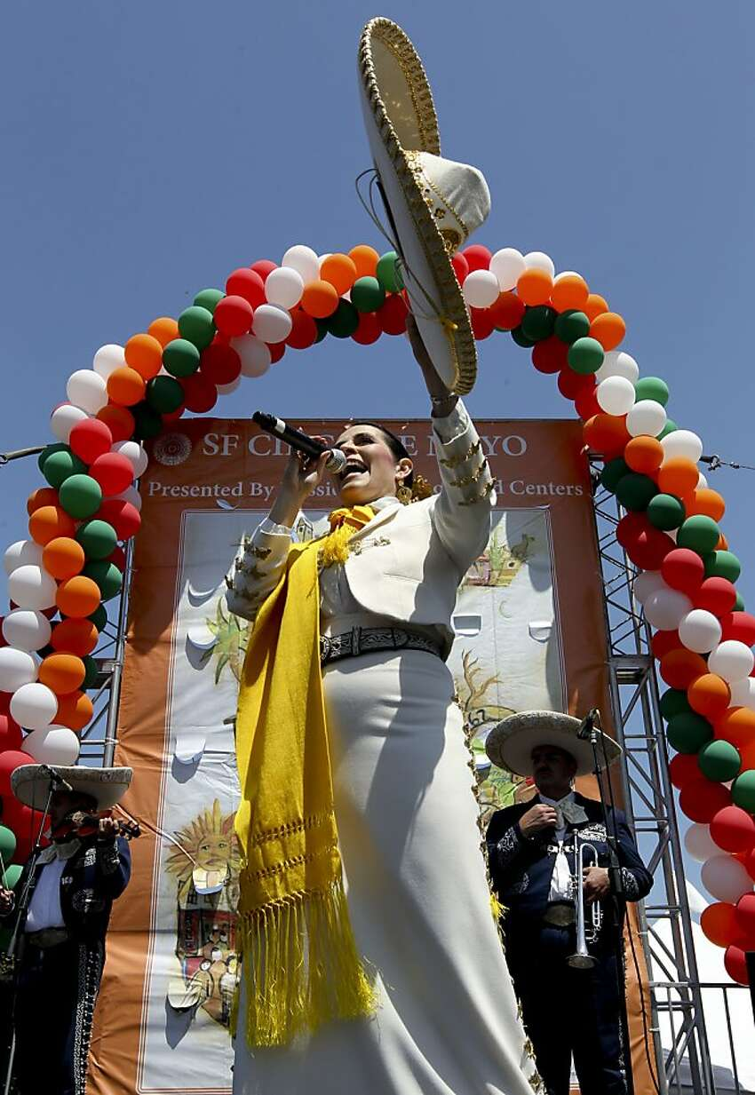 Singer, Ms. Berta Olivia belts out a song, during the annual Cinco de Mayo celebration in Dolores Park on Saturday May 5, 2012, in San Francisco, California.