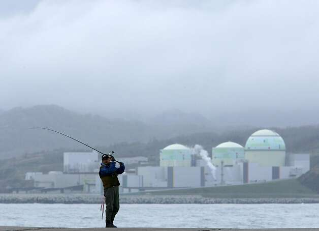 A man fishes in front of Hokkaido Electric Power Co.'s Tomari nuclear power plant in Tomari Village, Hokkaido, Japan, on Saturday, May 5, 2012. Japan will have no nuclear-generated electricity for the first time in more than four decades tonight after its sole operating power reactor is halted for scheduled maintenance. Photo: Tomohiro Ohsumi, Bloomberg