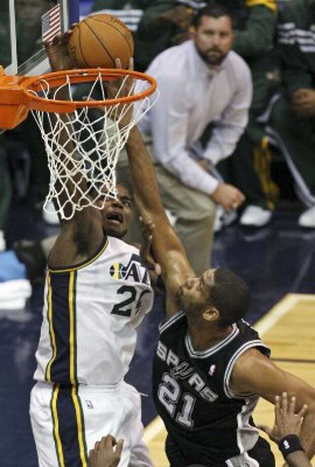 The Spurs' Tim Duncan defends the Jazz's Paul Millsap during first half action of Game 3 of the Western Conference first round Saturday May 5, 2012 at EnergySolutions Arena in Salt Lake City, Utah. (PHOTO BY EDWARD A. ORNELAS/SAN ANTONIO EXPRESS-NEWS) (EDWARD A. ORNELAS / SAN ANTONIO EXPRESS-NEWS)