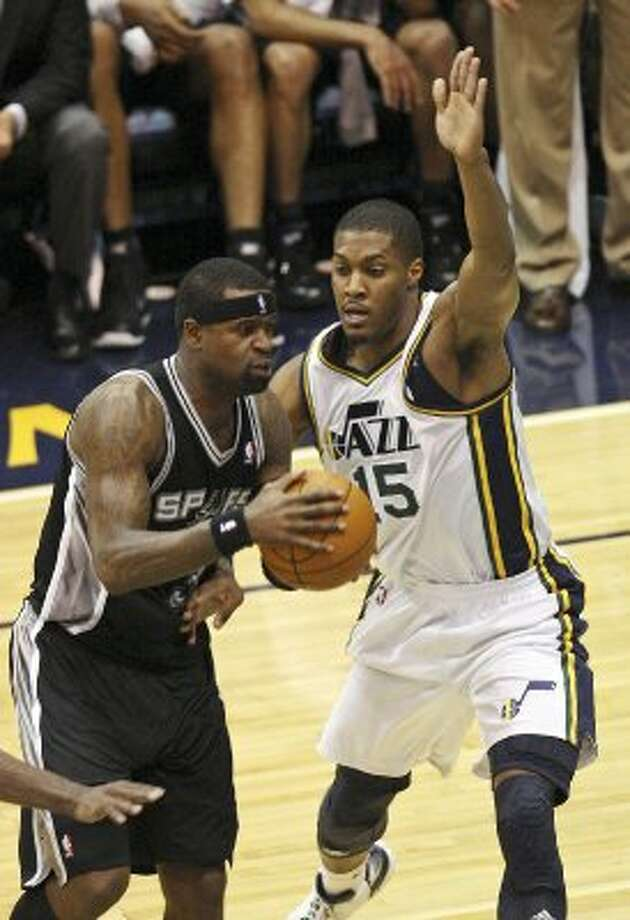 The Spurs'  Stephen Jackson looks for room around the Jazz's Derrick Favors during first half action of Game 3 of the Western Conference first round Saturday May 5, 2012 at EnergySolutions Arena in Salt Lake City, Utah. EDWARD A. ORNELAS/SAN ANTONIO EXPRESS-NEWS (EDWARD A. ORNELAS / SAN ANTONIO EXPRESS-NEWS)
