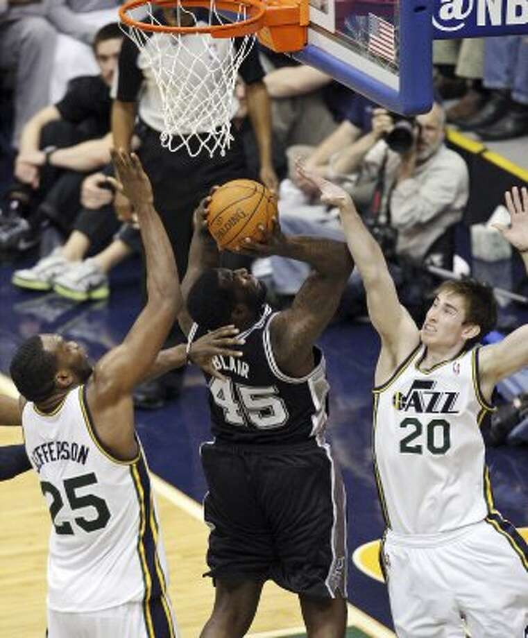 The Spurs'  DeJuan Blair shoots between the Jazz's Al Jefferson and Gordon Hayward during first half action of Game 3 of the Western Conference first round Saturday May 5, 2012 at EnergySolutions Arena in Salt Lake City, Utah. EDWARD A. ORNELAS/SAN ANTONIO EXPRESS-NEWS (EDWARD A. ORNELAS / SAN ANTONIO EXPRESS-NEWS)