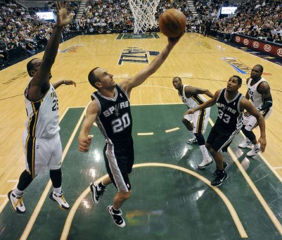 The Spurs'  Spurs Manu Ginobili shoots around the Jazz's Al Jefferson during first half action of Game 3 of the Western Conference first round Saturday May 5, 2012 at EnergySolutions Arena in Salt Lake City, Utah. EDWARD A. ORNELAS/SAN ANTONIO EXPRESS-NEWS (EDWARD A. ORNELAS / SAN ANTONIO EXPRESS-NEWS)