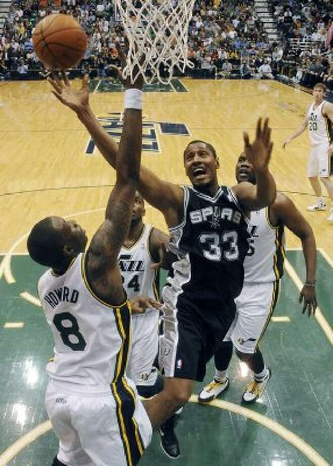 The Spurs'  Boris Diaw shoots around the Jazz's Josh Howard during first half action of Game 3 of the Western Conference first round Saturday May 5, 2012 at EnergySolutions Arena in Salt Lake City, Utah. EDWARD A. ORNELAS/SAN ANTONIO EXPRESS-NEWS (EDWARD A. ORNELAS / SAN ANTONIO EXPRESS-NEWS)