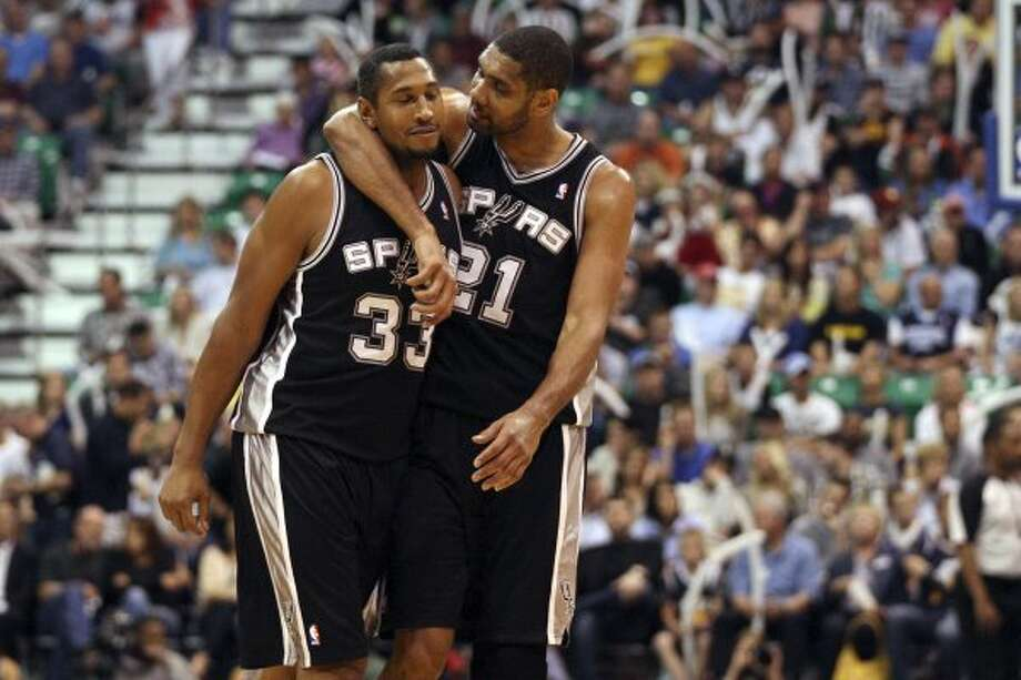 The Spurs'  Boris Diaw and Tim Duncan celebrate as they take a commanding lead during the fourth quarter against the Jazz in game three of the Western Conference first round at EnergySolutions Arena in Salt Lake City,  Saturday, May 5, 2012.  The Spurs won 102-90 and lead the series 3-0. Jerry Lara/San Antonio Express-News (Jerry Lara / San Antonio Express-News)