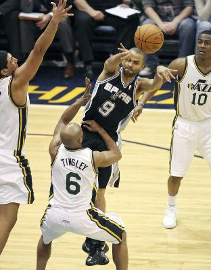 FOR SPORTS - San Antonio Spurs Tony Parker passes over  Utah Jazz Jamaal Tinsley during second half action of Game 3 of the Western Conference first round Saturday May 5, 2012 at EnergySolutions Arena in Salt Lake City, Utah. The Spurs won 102-90. (PHOTO BY EDWARD A. ORNELAS/SAN ANTONIO EXPRESS-NEWS) (EDWARD A. ORNELAS / SAN ANTONIO EXPRESS-NEWS)