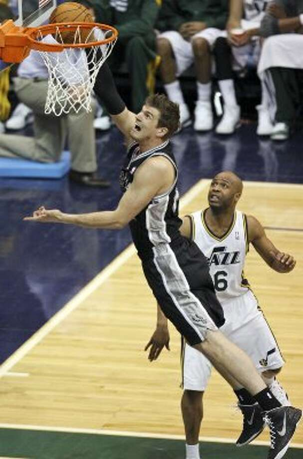 The Spurs'  Spurs Tiago Splitter shoots around the Jazz's Jamaal Tinsley during second half action of Game 3 of the Western Conference first round Saturday May 5, 2012 at EnergySolutions Arena in Salt Lake City, Utah. The Spurs won 102-90. EDWARD A. ORNELAS/SAN ANTONIO EXPRESS-NEWS (EDWARD A. ORNELAS / SAN ANTONIO EXPRESS-NEWS)