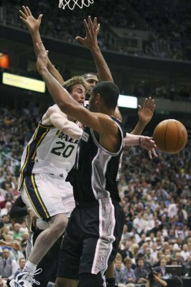 The Jazz's Gordon Hayward runs into the Spurs' Boris Diaw and Tim Duncan in the second half of game three of the Western Conference first round at EnergySolutions Arena in Salt Lake City,  Saturday, May 5, 2012.  The Spurs won 102-90 and lead the series 3-0. Jerry Lara/San Antonio Express-News (Jerry Lara / San Antonio Express-News)