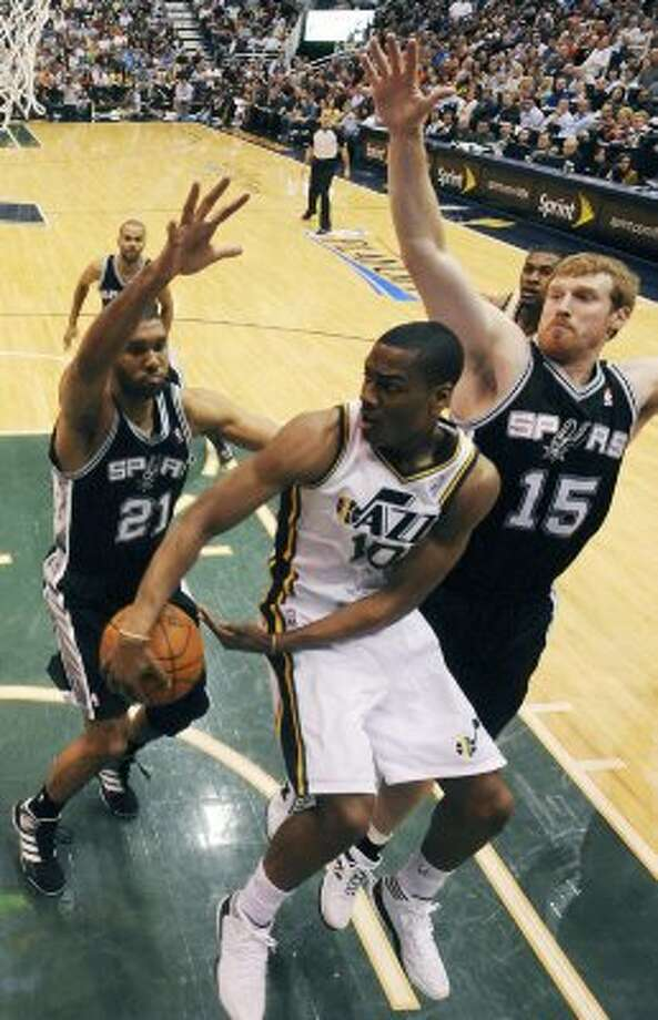 The Spurs'  Tim Duncan and Matt Bonner defend the Jazz's Alec Burks during second half action of Game 3 of the Western Conference first round Saturday May 5, 2012 at EnergySolutions Arena in Salt Lake City, Utah. The Spurs won 102-90. EDWARD A. ORNELAS/SAN ANTONIO EXPRESS-NEWS (EDWARD A. ORNELAS / SAN ANTONIO EXPRESS-NEWS)